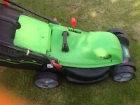 Electric lawnmower with grassbox used a few times only like new