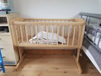 Swinging crib and bedding