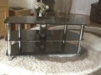 Large black and silver television stand