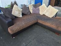 VERY COMFORTABLE LEATHER AND FABRIC CORNER SOFA .