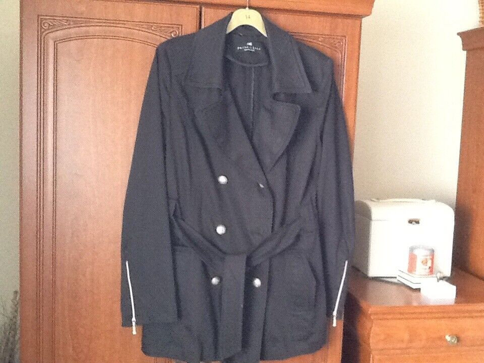 Dark navy jacket in excellent condition with zips and details on pockets