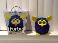 Purple and yellow Furby, mint condition never used. Works with iPad, iPhone and iPod touch.