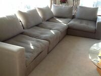 'L'-shaped 5+ seater sofa in grey fabric with cushions