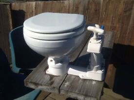 Hand operated boat toilet