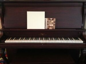 Bell upright piano with bench