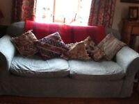 Large 3 seater sofa in mid green.