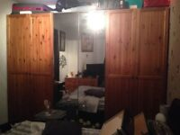 free to uplift. 4 ikea pax wardrobe doors. wood with handles. perfect condition.