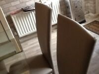Lovely 2yrs old dining tables with leather chairs
