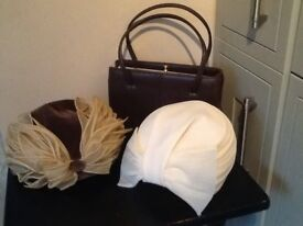 Two vintage ladies hats and vintage handbag .