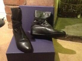 Stuart Weitzman pull-on Ladies ankle boots.