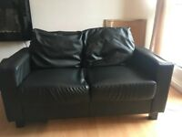 2 x black leather style sofas