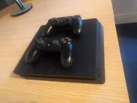 Playstation 4 slim 1TB with 2 dualshock controllers, rocket league and fallout 4.