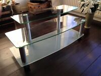 Glass and chrome TV stand on wheels
