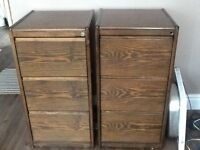 Two large walnut filing cabinets .