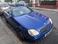Blue Mercedes SLK 230 Kompressor (automatic) convertible with aftermarket speaker setup