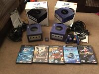 2 boxed gamecubes and games