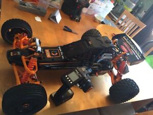 2 hpi baja 5b buggy's both rtr with upgrades trade ?