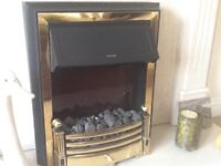 Berry electric fire brass surround .good condition with instructions