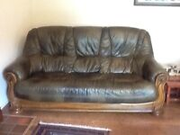 Good as new three-piece suite - olive green leather in a wooden frame