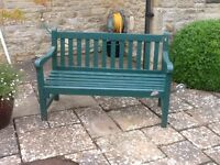 two seater green painted wooden bench