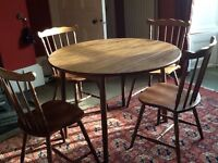 Round, folding dining table and four chairs
