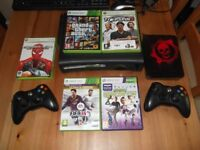 Xbox 360, 12 Games and 2 Official wireless controllers.