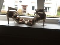 Lovely Dune caged heeled sandals, gold colour with cream piping. Never been worn