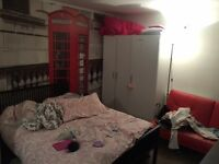 Room for share with a girl, one double bed, a singel bed, sofa, fridge, two wardrobes and a garden