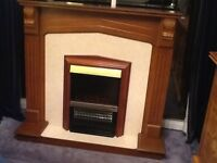 Electric fire and oak surround. Very heavy, would need two people to carry. Good condition