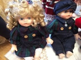 A pair of porcelain dolls.
