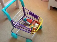 Children's toy trolley and food