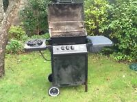 Gas barbecue with gas bottle.