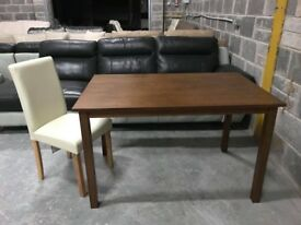 Wood dining table with leather chairs