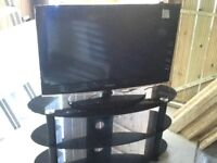 32inch Samsung T.V and Black Glass Stand very heavy