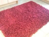 A deep shaggy acrylic and synthetic rug 140cm x200cm-used rug in good clean condition
