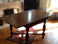 1920s oak dining table with 2 leaf extensions. Seats 6. Good condition for age.