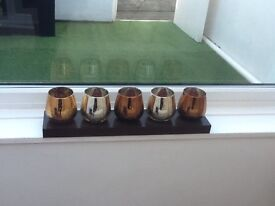 Set of candle holders on stand