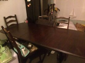 solid dark wood 6-8 seat extandable dining table with 8 chairs