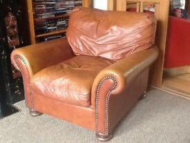 Leather sofa and armchair. £75 ONO