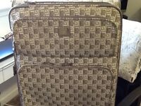 2x matching suitcases . Lovely condition they are of a tapestry type material with gold thread