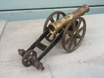 vintage model canon bronze or brass smaller size
