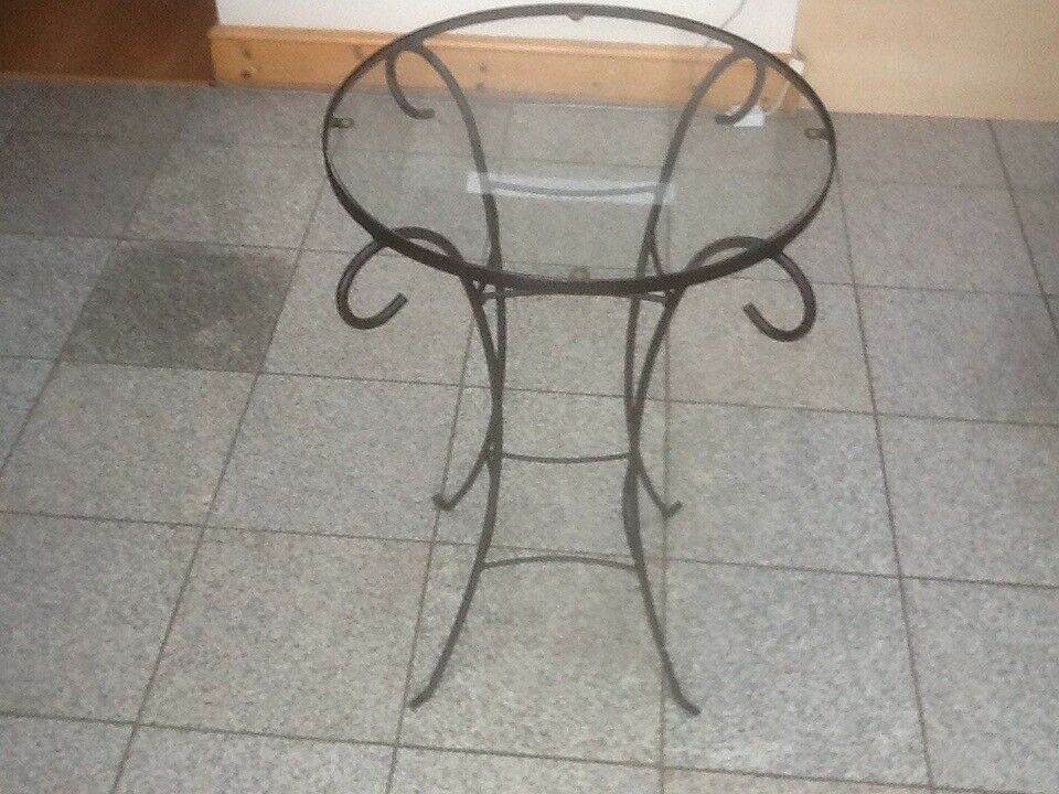 Metal framed,glass top side table 69cm height and 46cm diameter tabletop-£10 to clear