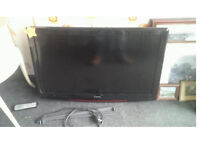 BAIRD 37 INCH TV HDMI FREEVIEW AND REMOTE ALSO WALL MOUNTED WITH LOCAKABLE ARM MOUNT SHOWN WORKING