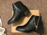 £25 New sheep skin black boots, size 4