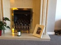 Gas fire for sale. Brass trim , coal effect with side ignition.