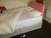 Double bed, divan bed, with pink headboard and drawers