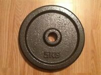 4 x 5kg metal plates. New in box.