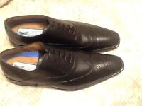 Brand new and unworn men's black shoes size 11