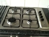 Gas hob with four burners