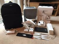 Phantom 4 + DJI Care + 2x Batteries + Navitech Backpack + Android Pixi Tablet + 8x Spare Propellers